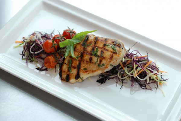 Blackened jerk chicken breast served with The Cycle Bistro signature coleslaw.