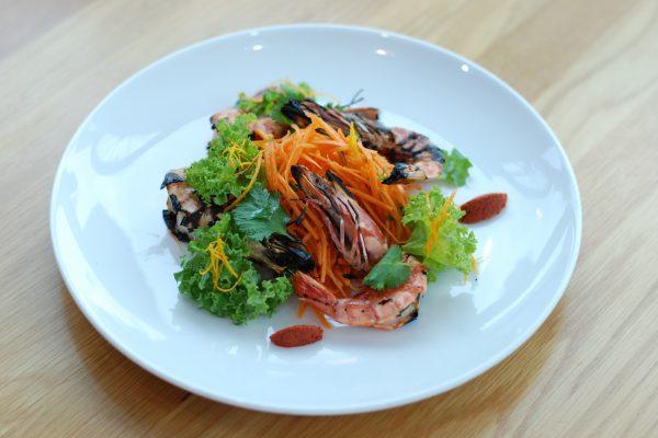 Grilled shrimps with carrot, orange and coriander salad