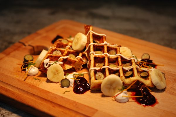 Homemade Paleo Waffles with banana cashew cream and blueberries compote